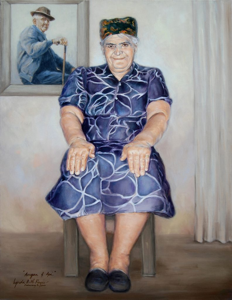 portrait of seated elderly woman with portrait of man behind her