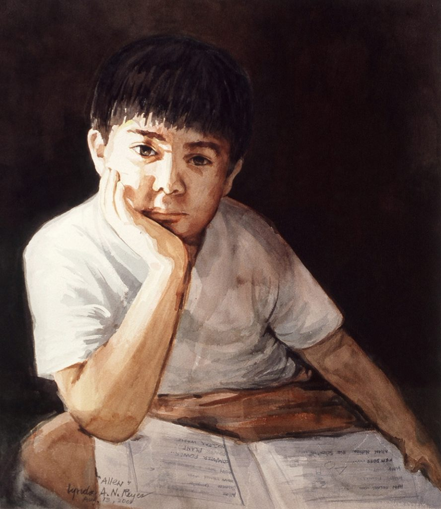 portrait of young boy with an open book on his lap gazing at viewer
