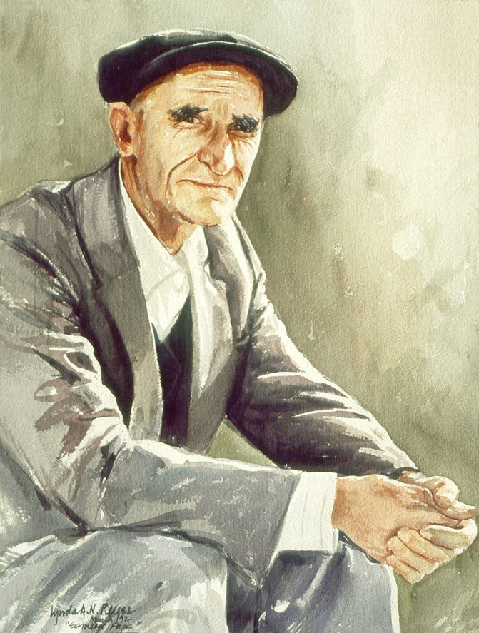 seated man looking at viewer
