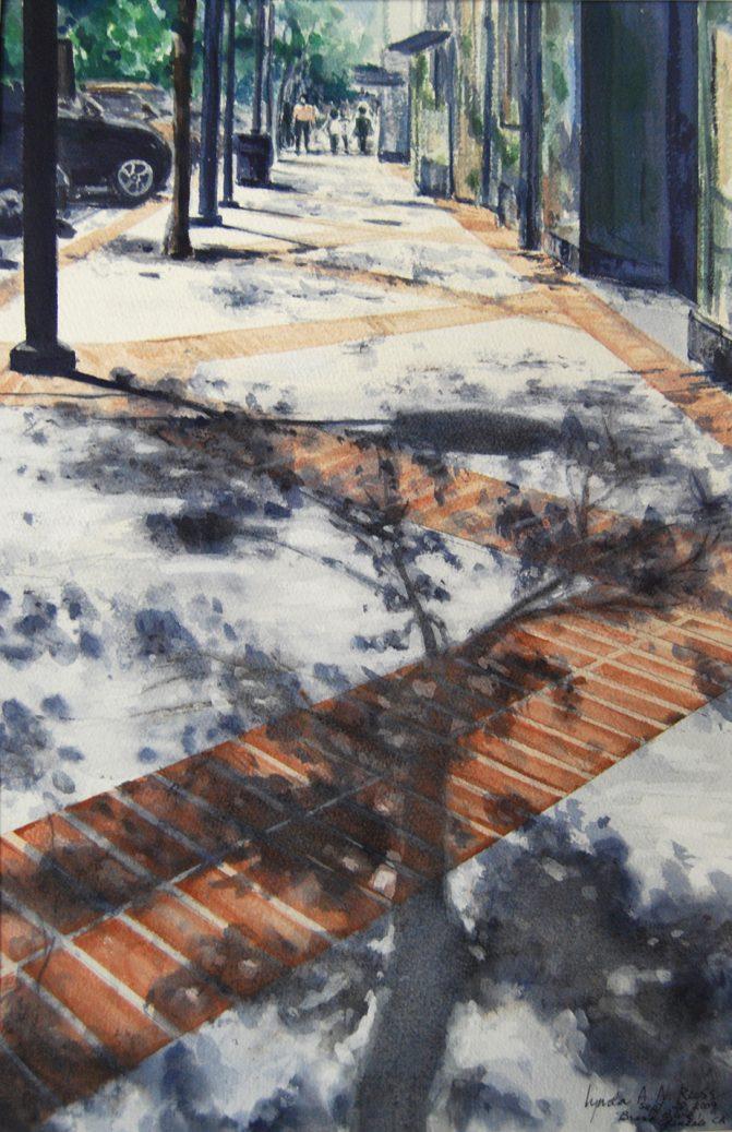 shade on brick and concrete sidewalk