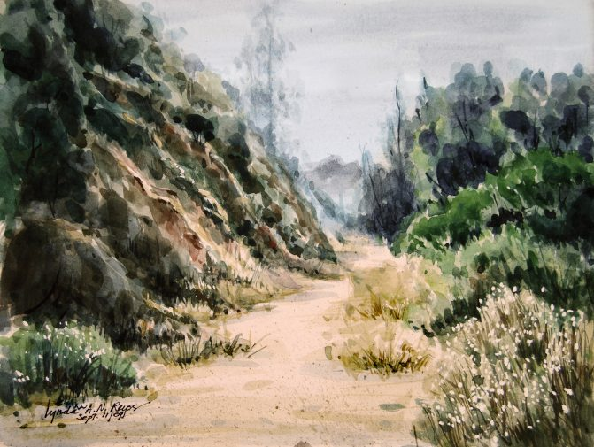 watercolor painting of a pathway between a rock face and trees